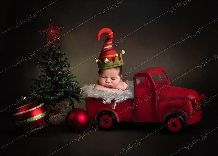 بک دراپ نوزاد ماشین و درخت کریسمس