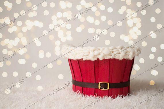 بک دراپ نوزاد بوکه و سبد قرمز کریسمس