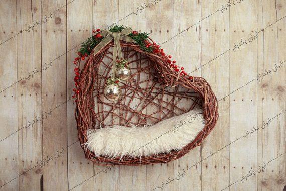 بک دراپ نوزاد قلب با زنگوله های کریسمس