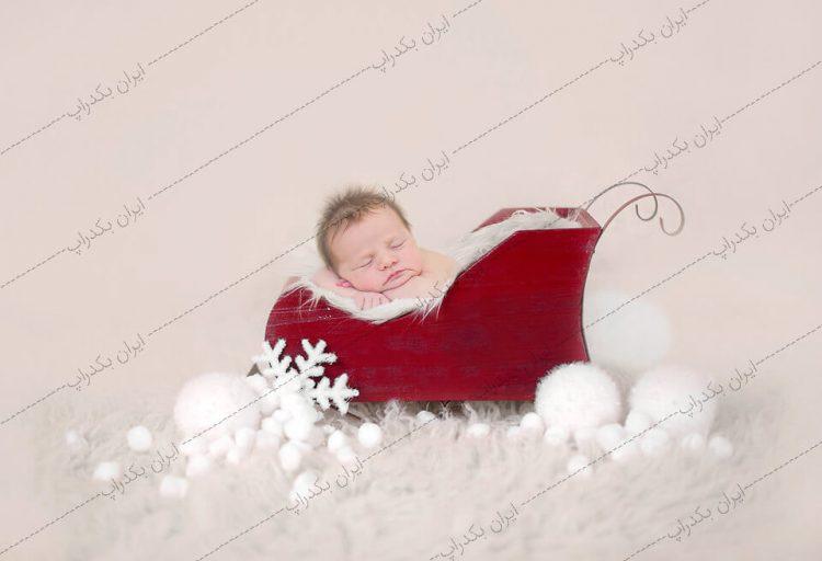 بک دراپ نوزاد سورتمه برفی