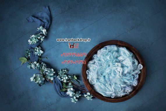 بک دراپ عکاسی نوزادی گل های آبی